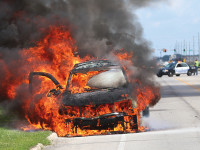 Fire engulfs SUV and boat