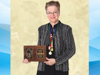 Clear Lake photographer honored for her dedication to profession and focus on business
