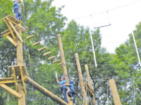 Girl Scouts cut the ribbon on new ropes course at Camp Tanglefoot