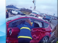 Firefighters use Jaws of Life to free two trapped in vehicle after crash