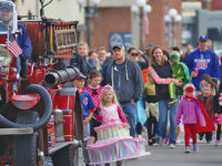 Super heroes to ghosts march in Halloween parade