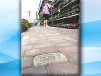 Personalized bricks cause a hiccup in sidewalk project
