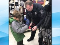 Officers team up  with kids for Christmas shopping