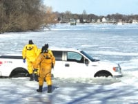 No injuries after vehicle plunges into Clear Lake