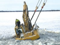 No injuries as  excavator breaks through lake ice