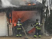 Fire destroys Outing Club garage