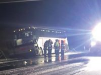 Crisis averted after bus crashes into barrier on Interstate 35