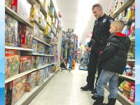 Kids and cops team up for holiday shopping event