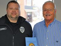 Former police chief turns memories into Benevolence fundraiser