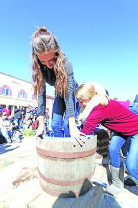 Rissa Barragy stomped the grapes while her friend, Madison Finstad tried to get the juices flowing in the Grape Stomp Competition.